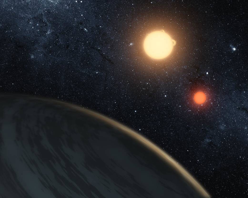 This artist's concept illustrates Kepler-16b, the first planet known to orbit two stars - what's called a circumbinary planet. The planet, which can be seen in the foreground, was discovered by NASA's Kepler mission. New research from the University of Washington indicates that certain shot-period binary star systems eject circumbinary planets as a consequence of the host stars' evolution.