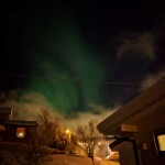 green bands of lights in dark sky