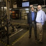 Two men standing in a particle physics laboratory