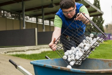 "In addition to readying the driving range before it opens, Matthew Skelly also works in the flower beds and trims the hedges and blackberries. ""I prefer a mixture of things to do, no matter what the weather is,"" he said."