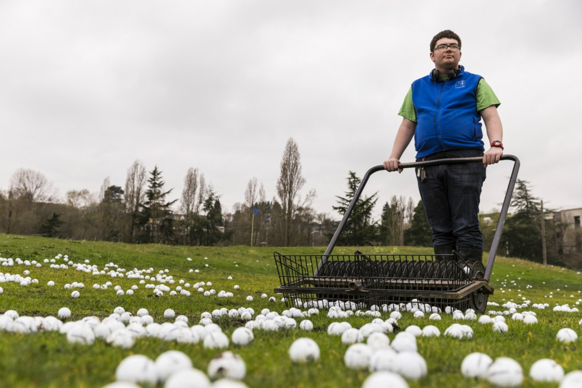 "Matthew Skelly, an intern with project SEARCH, retrieves golf balls four mornings a week at the UW driving range. ""In middle school, my dream job was to be a bus driver,"" Skelly explained. ""Then I decided I wanted to be a flight attendant. This program helped me learn what else I might want to do for a job."""