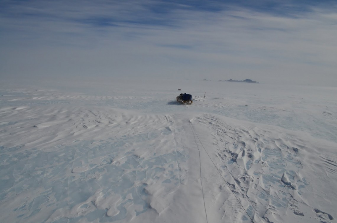 blue ice with sled in distance