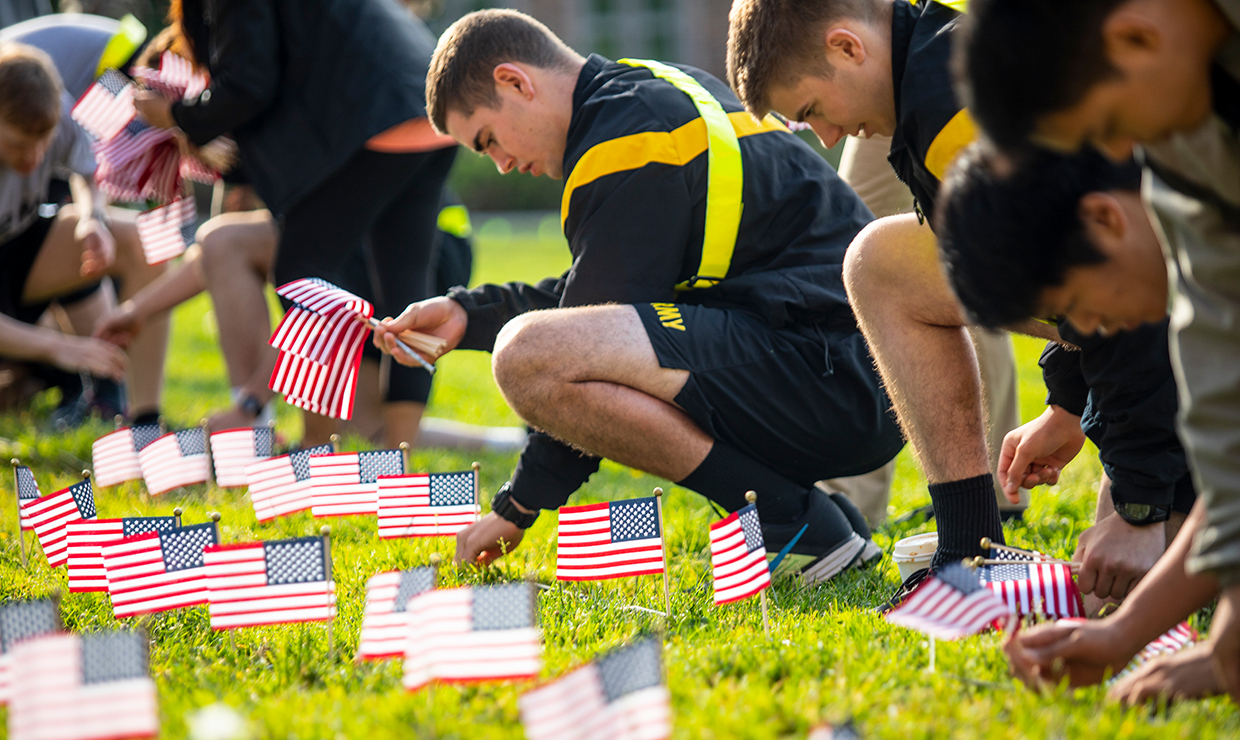 Student veterans and other volunteers place nearly 7,400 flags on the HUB lawn to recognize the number of U.S. veterans who died by suicide in one year.