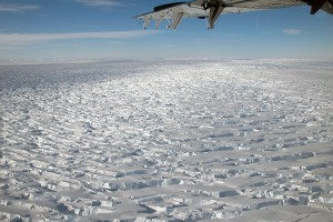 ridged ice with airplane wing in foreground