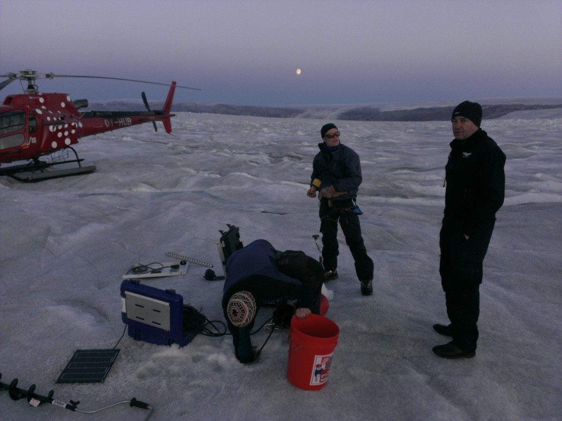 researchers standing with equipment on ice
