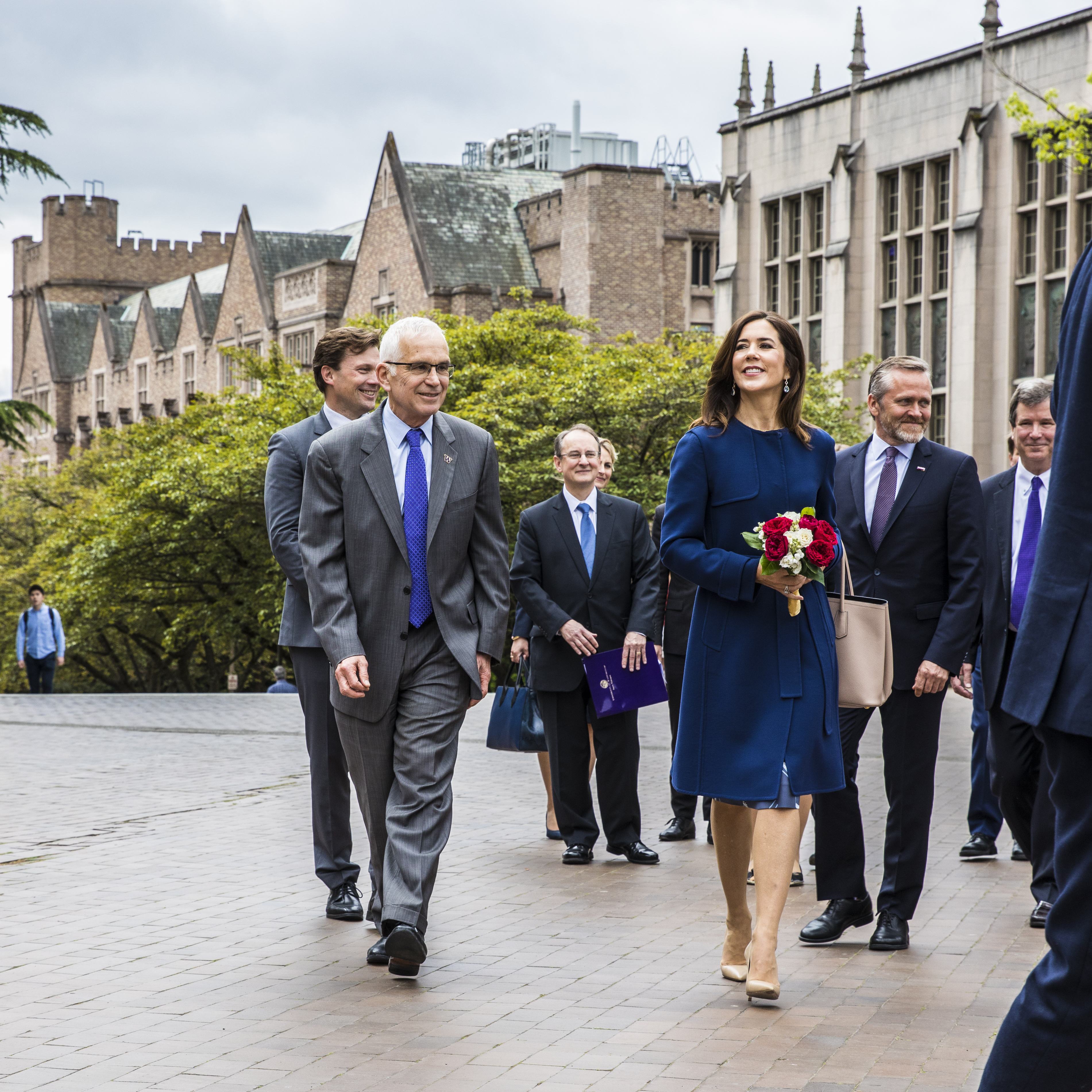 Denmark's Crown Princess Mary walks across Red Square accompanied by Provost Jerry Baldasty.