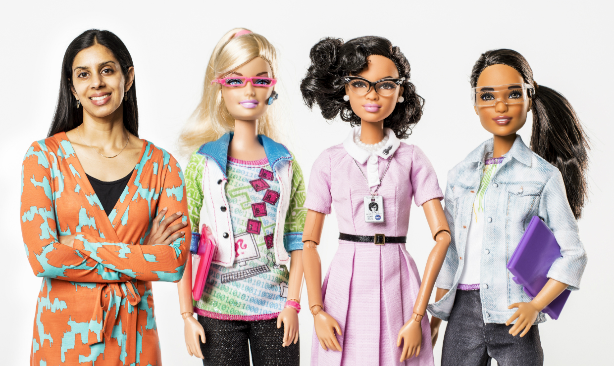 Sapna Cheryan, UW associate professor of psychology, with her Barbie dolls (made to look life size): computer engineer, Katherine Johnson and robotics engineer.