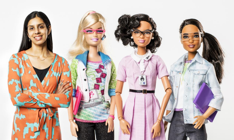 Sapna Cheryan, UW associate professor of psychology, with her Barbie dolls (made to look life size): computer engineer, Katherine Johnson and robotics engineer.