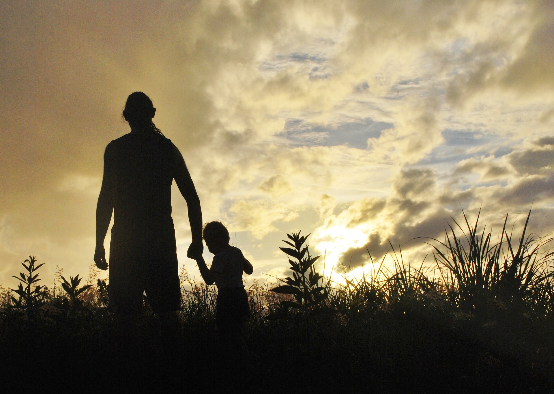 A University of Washington study finds that parents who took mindfulness lessons were better able to manage their emotions, and their children's behavior improved, as well. Photo of a father walking with his young son.