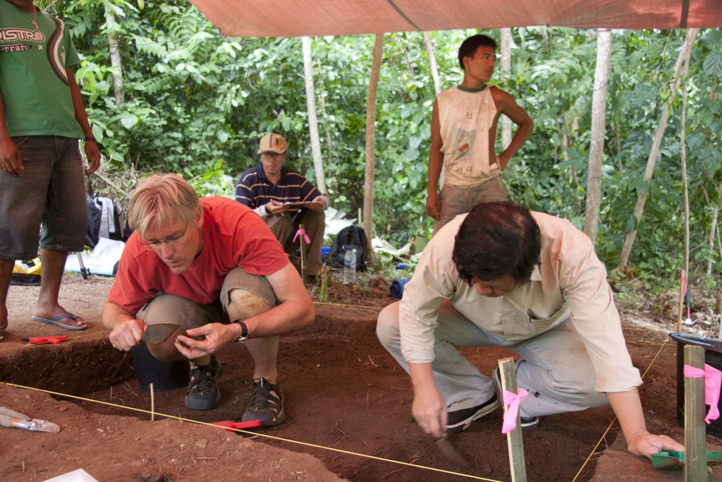 Burke Museum Archaeology Curator Peter Lape (left) and Daud Tanudirjo (right) excavating a layer at the site with the earliest known cooking use of nutmeg. Photo of two men digging at a site.