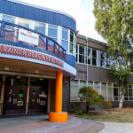 Rainier Beach High School in Southeast Seattle was proposed for closure in 2008, but community members rallied around a new vision for the school. Photo of front of school building.