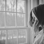A study of PTSD patients led by the University of Washington finds that people who chose their form of treatment were more apt to stick to their program and eventually become diagnosis-free. Photo of woman looking out a window.