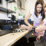 A UW postdoc works with Center for Neurotechnology Young Scholars Program participant on a sensory device.