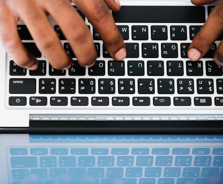 person typing at a keyboard