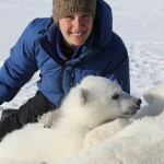 Laidre in blue parka with polar bear cubs