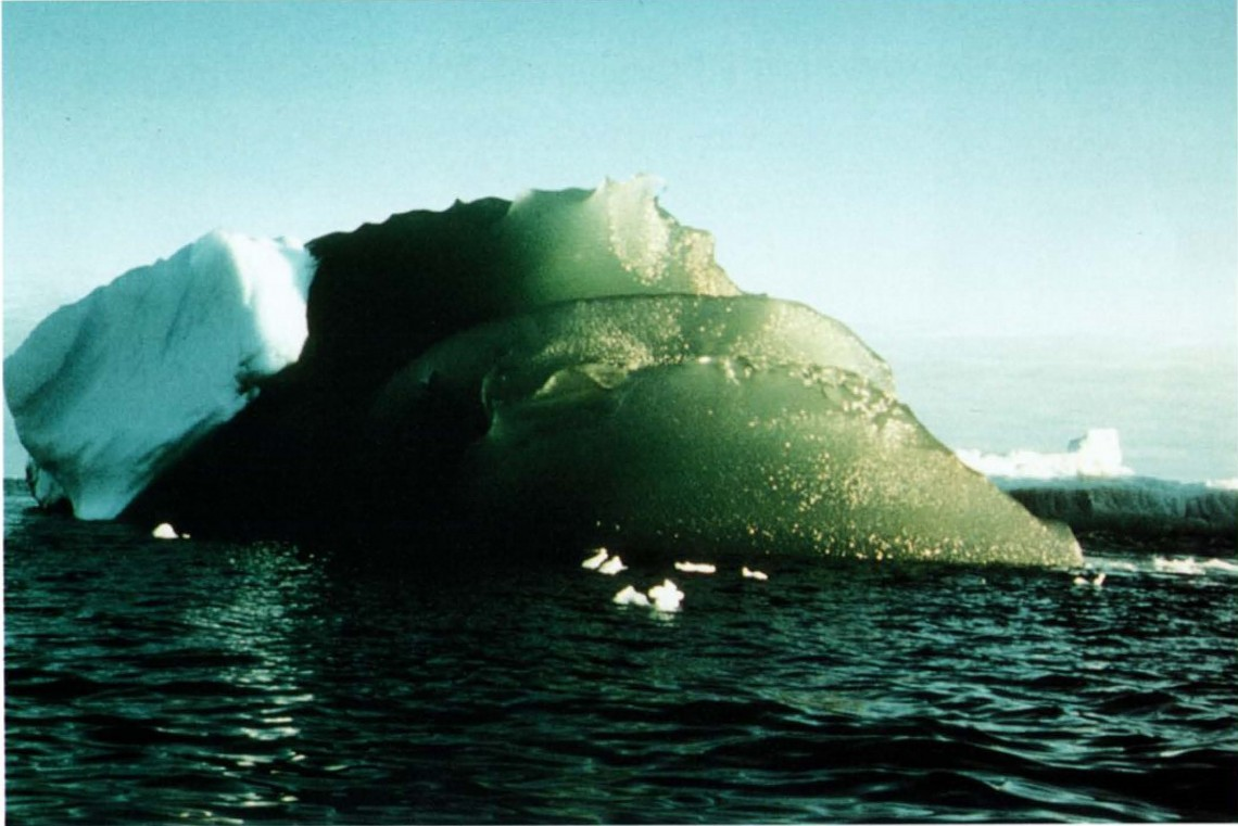 green iceberg on blue background