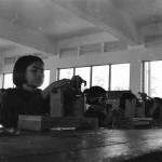 This is one of dozens of photographs of Cambodian citizens, taken by journalist and UW alum Elizabeth Becker on her tour of the country in 1978. Photo of young girl in a factory