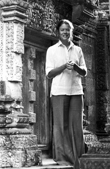 Elizabeth Becker was a Washington Post reporter in 1978 when she was one of two journalists from mainstream Western media invited to visit Democratic Kampuchea, as Cambodia was then known. Photo of woman standing against a wall.