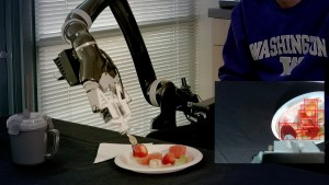 The robot skewers a strawberry
