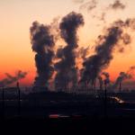 industry smokestacks at sunrise