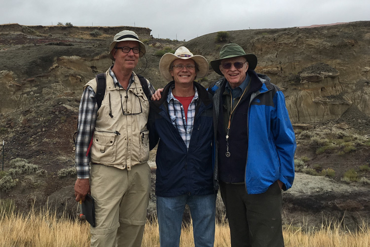 three researchers at field site