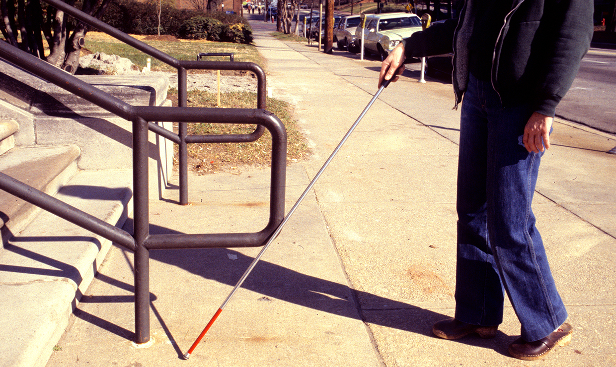 People who are visually impaired rely on other senses to interpret their surroundings. A pair of studies from the University of Washington shows how the brains of blind people adapt to process information. Photo of blind person walking with cane.