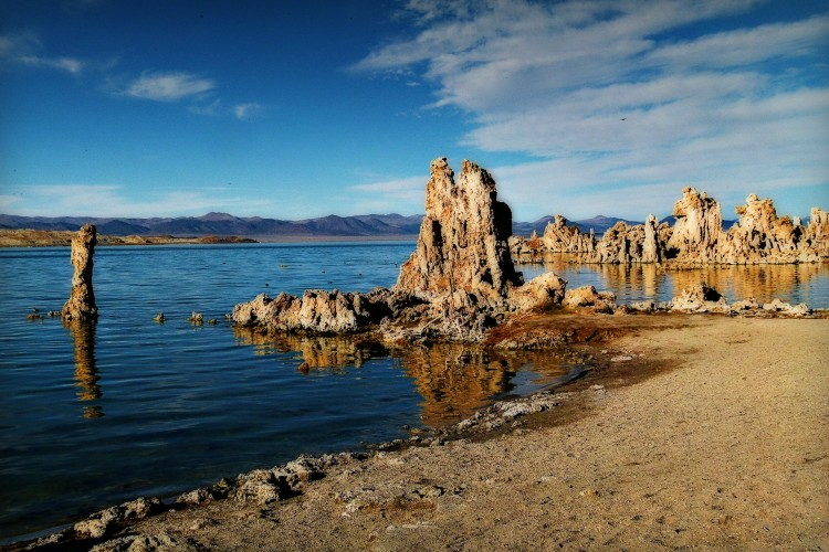 jagged rocks in blue lake