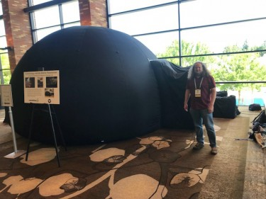 UW astronomy professor Rory Barnes with the astronomy department's mobile planetarium at the astrobiology conference AbSciCon2019 Wednesday.