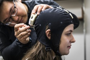 A graduate student adds an EEG to the first Sender in this experiment