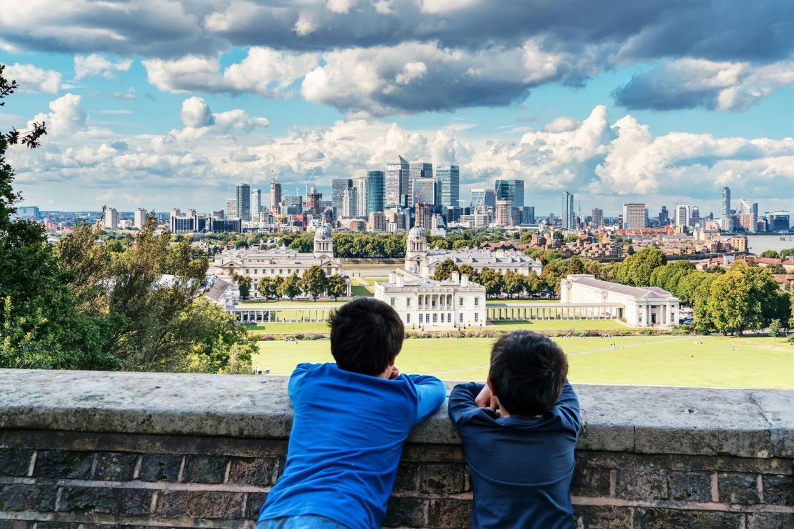 children look out at city