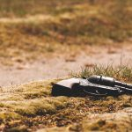 Gun in field grass