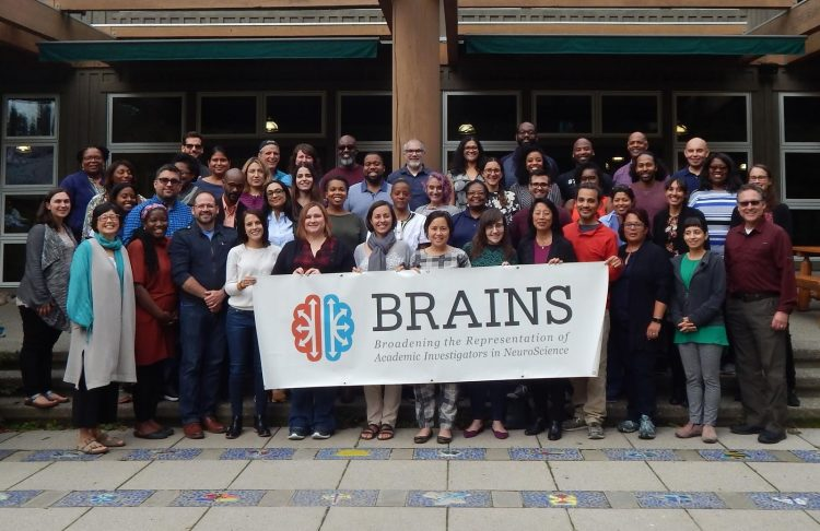The 2019 cohort for the BRAINS program, or Broadening the Representations of Academic Investigators in NeuroScience. Program evaluator Cara Margherio is in the back row, two people to the left of the post. Co-director Claire Horner-Devine is at the far right. Laura Ciotto , program operations, is at the far left. Co-director Joyce Yen is at the far left, middle row. Director Sheri Mizumori is fifth from the right in the front row.