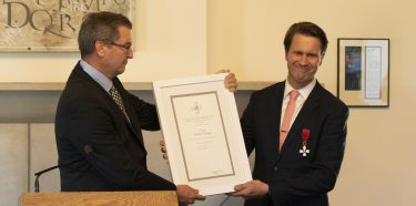 Andrew Nestingen (right), chair of the UW's Department of Scandinavian Studies, receives the Knight First Class of the Order of the Lion of Finland from Stefan Lindström, Finland's Los Angeles-based Consul General.