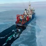 ship surrounded by ice