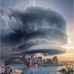 "A Facebook post that shows a picture of a crazy cloud formation over Sydney. The text above the picture says ""A friend posted this pic of last night's storm in Sydney. Think there might be a craft in there somewhere?"""