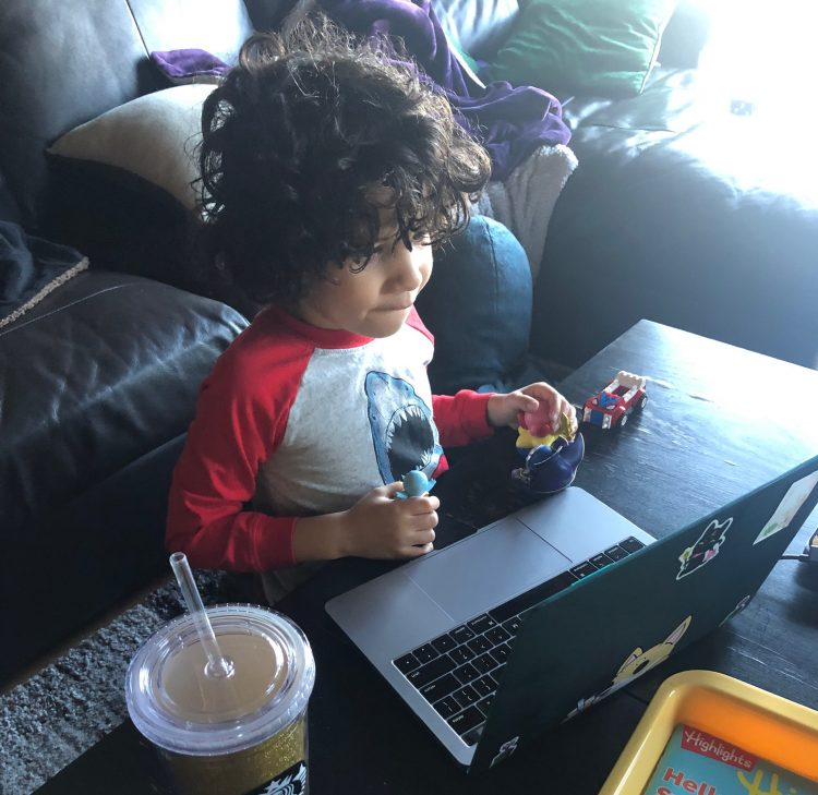 A child in front of a laptop.