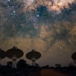 A picture of a radio telescope in Australia pointing up to the Milky Way