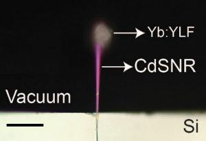 An image of an experiment where researchers used a laser to cool a semiconductor material.