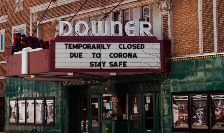 Newswise: movie-theater-covid19-sign-750x448.jpg