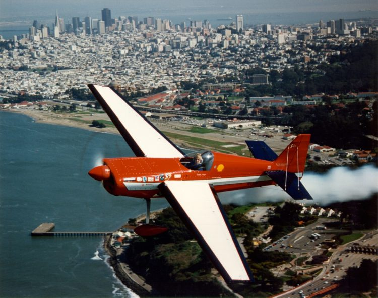 """Cecilia Aragon flies her custom-built air show plane, a Sabre 320, over San Francisco bay. Aragon has published a memoir, """"Flying Free: My Victory Over Fear to Become to the First Latina Pilot on the US Aerobatic Team."""""""