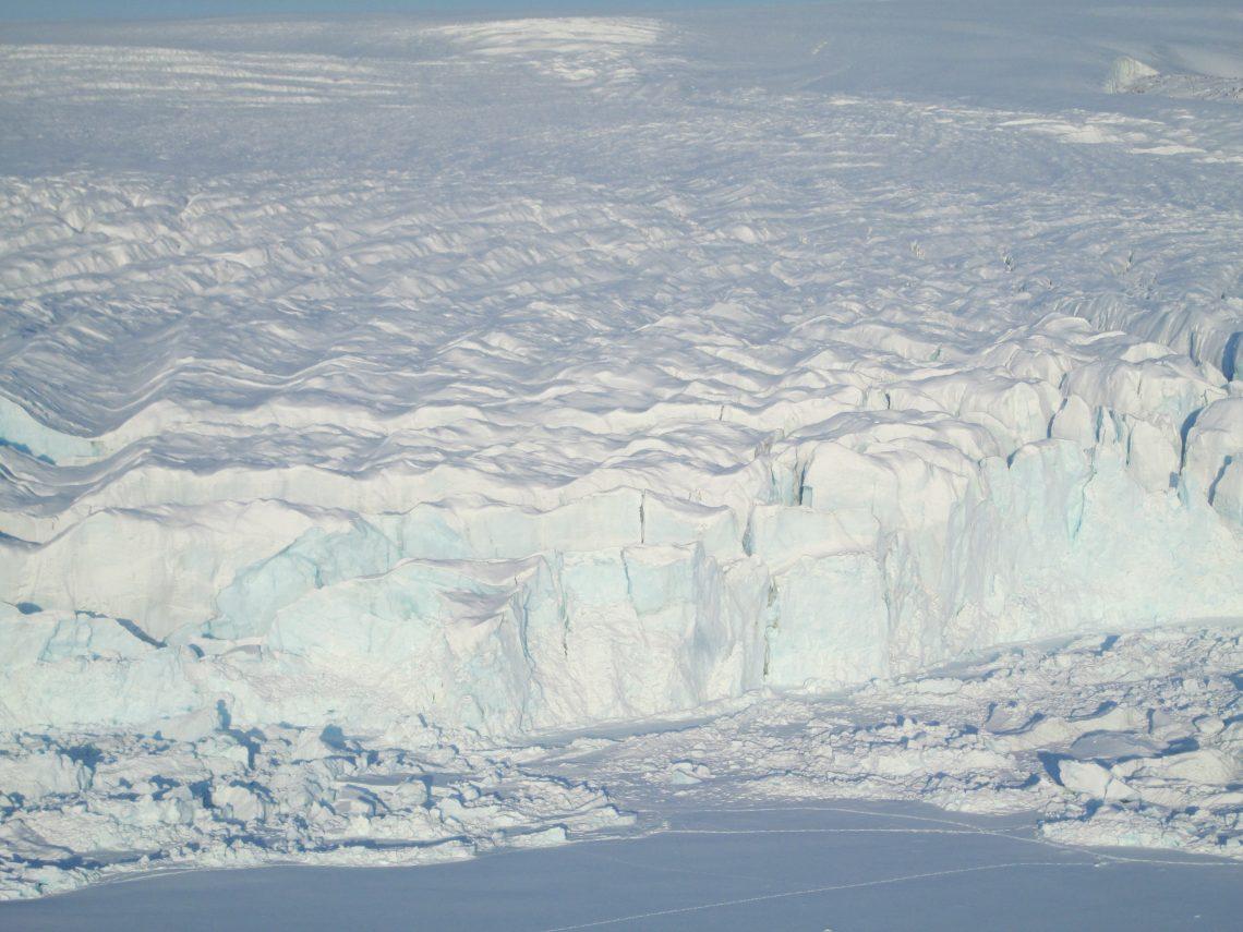 glacier with small footprints at base