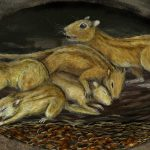 An illustration of ancient mammals in an underground burrow.