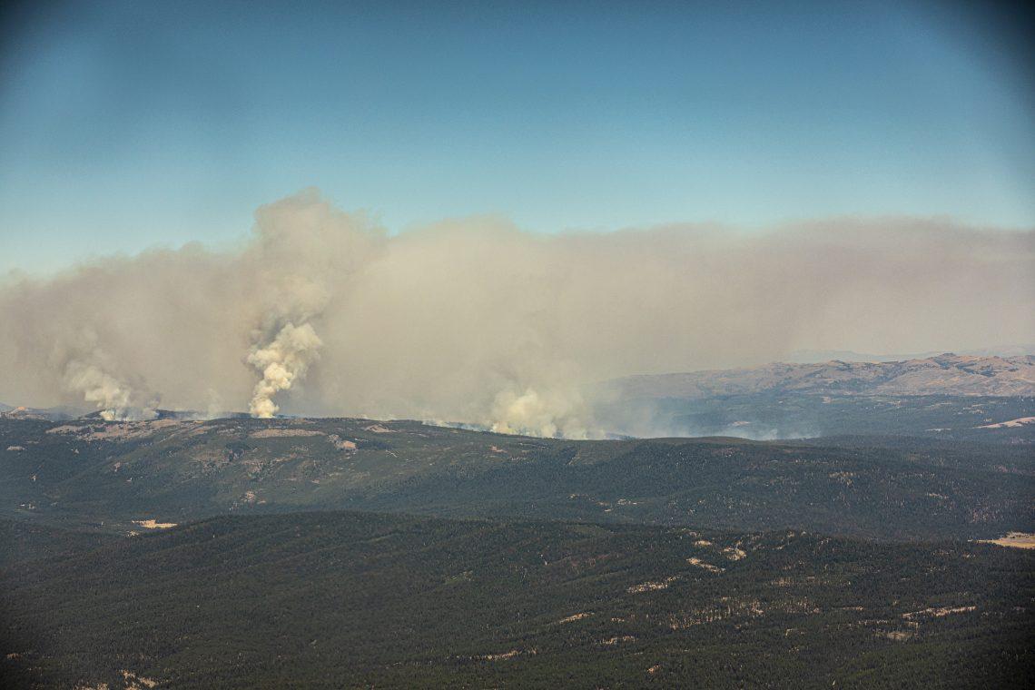 big smoke plume through aircraft window