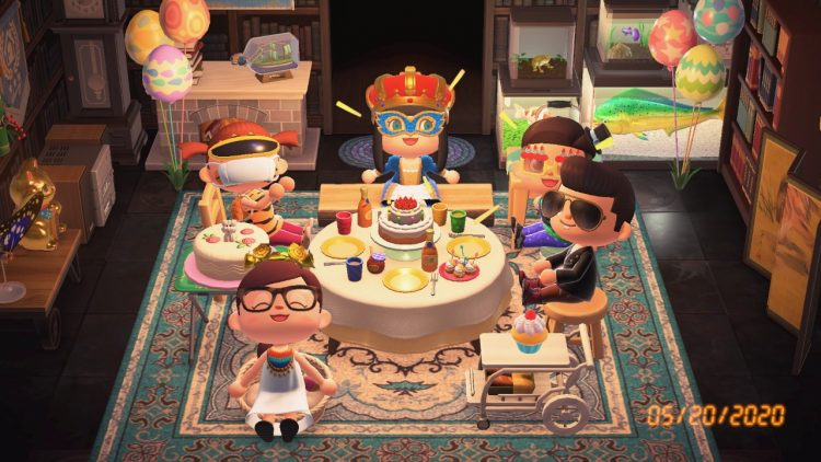 A screenshot of people gathered around a table in the game Animal Crossing. There are cakes and balloons and everyone is smiling.