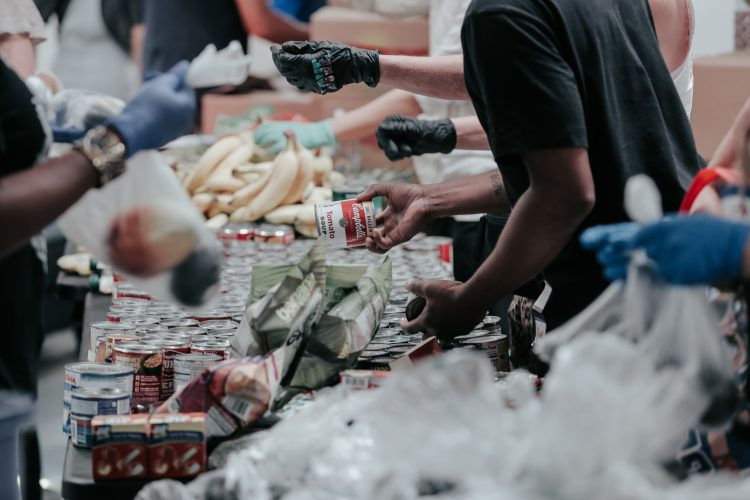 people handing out food at a food bank