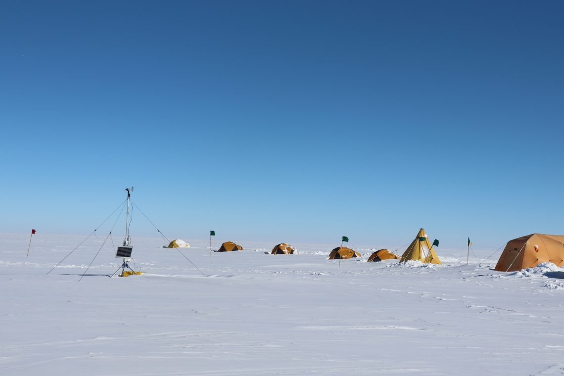 yellow tents on white snow