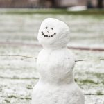 smiling snowman on campus