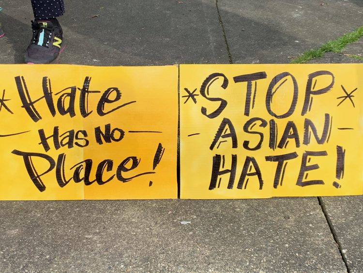 """Signs read """"hate has no place"""" and """"stop Asian hate"""""""