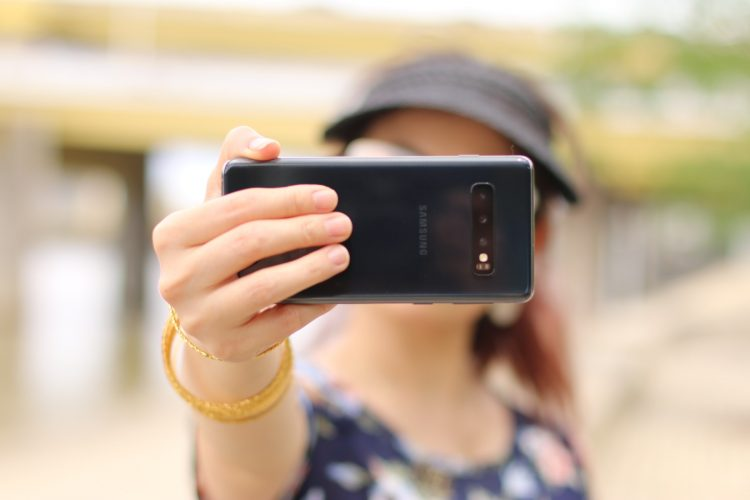 A person holding a phone in front of their face