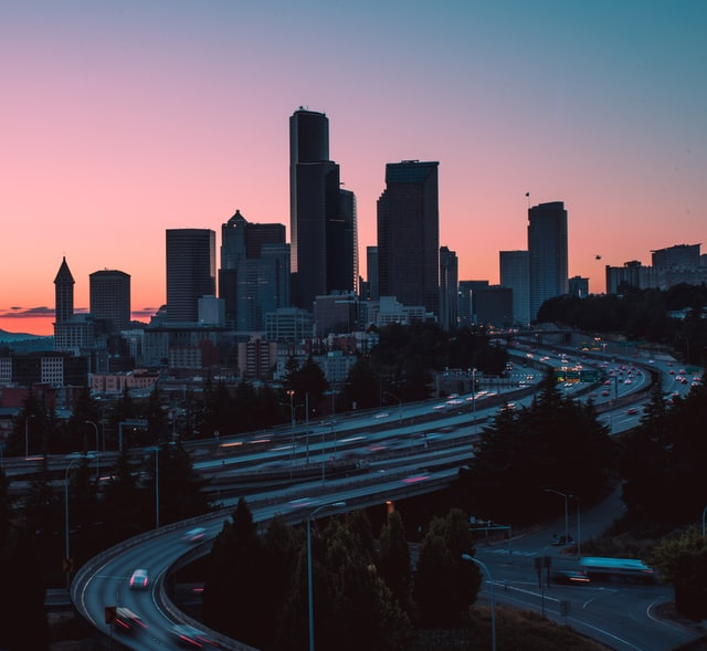 traffic on Interstate 5 through downtown Seattle at sunset